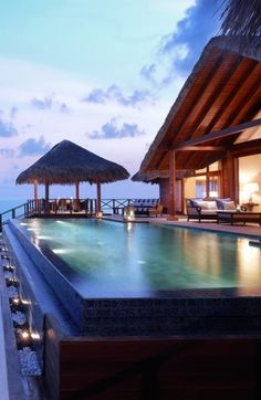 Thatch-roofed overwater villas, butlers and a sparkling lagoon make up this palm-studded paradise island