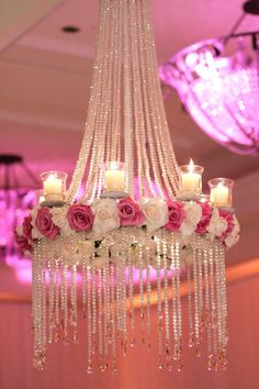 Floral chandeliers are the hottest wedding trend at the moment, will you be having one at yours like this crystal chandelier with pink and white roses?