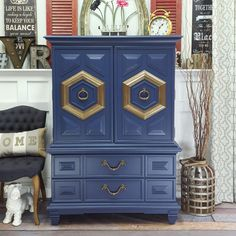 Gorgeous Mid-Century tallboy. Love the blue with brass.