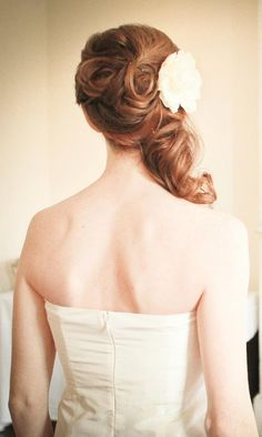 side updo half up with pin curls with flower.
