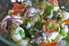 Marinated Poached Italian Seafood Salad or Insalata Frutti di Mare is a favourite dish from Southern Italy served for the Feast of the Seven Fishes.