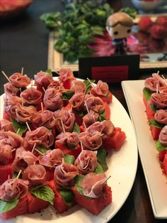 Prosciutto roses with basil on watermelon for Anderson's Hannibal themed birthday party. August 2017.