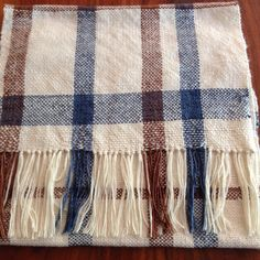 White brown and denim blue shawl approx 105cm long and 130cm with tassels x 45cm wide.  The shawl is hand woven from beautiful designer merino silk yarn (Louisa  Harding and Malabrigo).