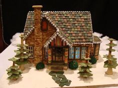 VERY cool change for the typical gingerbread house! VERY cool change for the typical gingerbread house! Cool Gingerbread Houses, Gingerbread House Designs, Gingerbread House Parties, Gingerbread Village, Christmas Gingerbread House, Gingerbread House Pictures, Homemade Gingerbread House, Graham Cracker Gingerbread House, Gingerbread Train