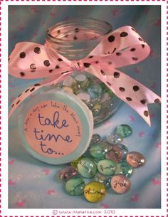 take time to.....jar.  contains glass beads with thoughts decopaged onto the back of them.