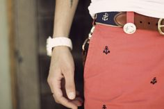 Red skirt with navy blue anchor print and navy belt