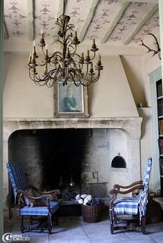 Great fireplace and chandelier. Love the chairs.