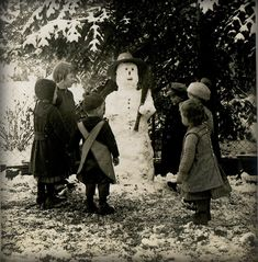 old snapshot of children around a Snowman.