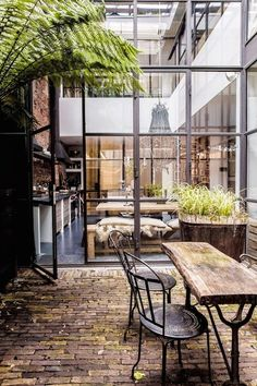 Metal frames, glass, bricks (Industrial home in the city of Amsterdam)