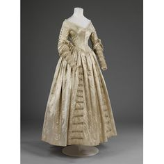 Wedding dress  Place of origin: England, Great Britain (made)  Date: 1841 (made)  Artist/Maker: Unknown (production)  Materials and Techniques: figured silk satin with net and lace trimming | V&A Search the Collections