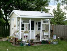 Cute Lil Shed, Decorated Like A House, Can Use For Storing Garden Tools,
