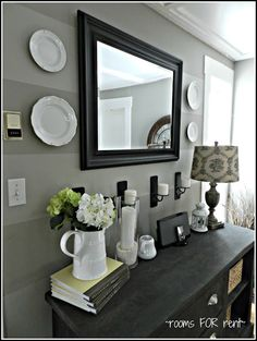 Flat wood frame mirror. Take a tall mirror turn it over on it side.  Sand wood than paint it a lighter color than walls. Hang it on it side on wall. 72 or 90 inches long.