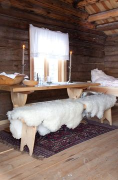 Lovely dining area with sheepskin on benches, Norway- yes! I love this! Cozy and simple....I'm so tired of stuff!