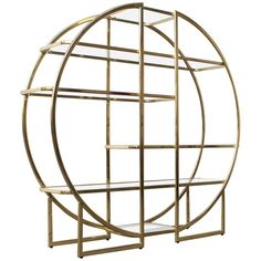Circular Brass Etagere with Glass Display Shelves | From a unique collection of antique and modern vitrines at https://www.1stdibs.com/furniture/storage-case-pieces/vitrines/