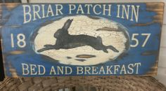 Primitive folk art Briar Patch Inn Bed and Breakfast wood sign rabbit blue Country Wood Signs, Barn Wood Signs, Wooden Signs, Primitive Signs, Primitive Folk Art, Primitive Labels, Primitive Crafts, Antique Signs, Vintage Signs
