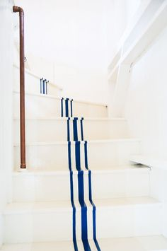 Blue painted stripes on white stairs