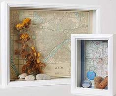 love these DIY show off boxes. Put a map in a shadow box and then add memorable stuff from the city/place.