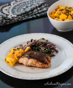 Moroccan Roasted Salmon with Mango Salsa and Quinoa Spinach - Quick dinner, because you just rub the salmon with harissa and throw together the easy sides while it bakes.