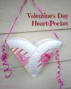 Super simple Valentine's Day craft for kids. Just need two cheap-o paper plates and ribbon. Kids could use them to collect their cards in class.