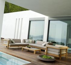 The Tribu Pure Sofa collection is made up of thick luxurious cushions and contemporary teak frame. A timeless design emerges as the teak frame silvers off in the sunlight, and the outdoor cushions remain rich in colour. Furniture, Outdoor Sectional Sofa, Garden Sofa, Teak Furniture, Outdoor Lounge, Teak Outdoor, Outdoor Sofa, Teak Table Outdoor, Teak Outdoor Furniture