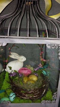 Easter terrarium. Wardian case, cloche, Easter bunny, Easter basket with eggs, moss Robins eggs