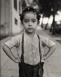 """Girl with Curlers, Los Angeles, 1949"" By Ida Wyman"