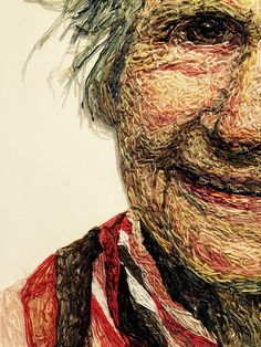 """Close-up of her mother's portrait - from the """"Dementia Darnings"""" exhibit by Jenni Dutton, at the Festival of Quilts 2015 in Birmingham, England - photo by Lissa, via modalissa blog;  """"Using [photos of her mother], the large portraits, constructed using THREADS sewn through netting that was stretched over canvas, became a way for Jenni to explore the concept of aging and her mother's gradual loss of memory."""""""