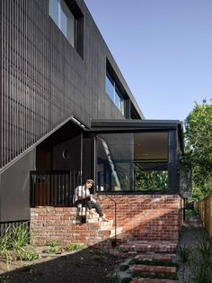 Paddington House is a private residence recently completed by Brisbane-based Kieron Gait Architects. The idea of the long hallway connects . Black Cladding, Timber Cladding, Exterior Cladding, Residential Architecture, Modern Architecture, Recycled Brick, Queenslander, Street House, Classic House