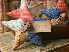 Instructions on this cute fabric star~ (love this for a rustic Christmas tree, need jute bows and hangers, love the rusty jingle bell, I might leave off the tags)