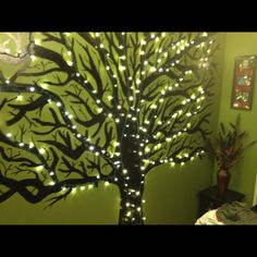My friends home...her bf painted a black tree on the wall and they added lights...AMAZING!