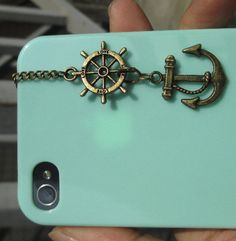 nautical iPhone headphone jack dust plug wheel & anchor. Please follow me and I will follow you back. I am working on getting more of a variety of pins and building my account.