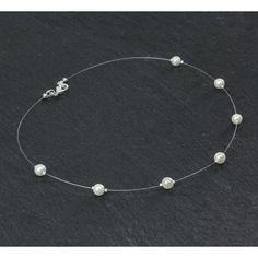 Collier mariage AURELIA.  Collier mariage sur fil nylon et plaqué argent composé de perles de verre nacrées ivoire.