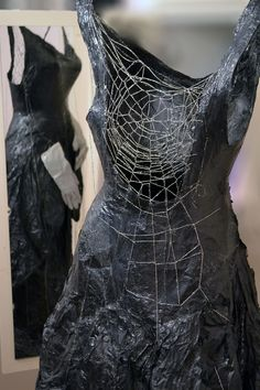 """A story sewn with the web of myth"" Tissue paper , thread with silver, vintage gloves. 150 x 65 x 40, 2017"