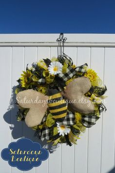 http://www.saturdaysboutique.etsy.com Cute Bumblebee Spring Wreath. Bulap Bumblebee centerpiece, yellow burlap deco mesh and black jute were purchased at http://www.trendytree.com