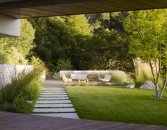 Strong route of flow out to an entertaining lounging terrace set into the lanscape