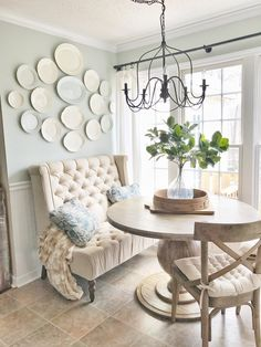 Farmshouse Breakfast Nook with a French Flair- Mixed Seating Options. And a DIY White Plate Wall. Read More on Plum Pretty Decor and Design's Blog.