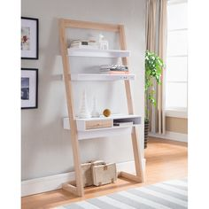 With an intriguing ladder design, this desk will surely be an eye catcher. With a total of three white shelves supported by a weathered white frame, this desk proves to be both beautiful and versatile White Shelves, Built In Shelves, Open Shelves, Desk Shelves, Stair Shelves, Ladder Shelves, Wall Shelving, Shelving Ideas, Floating Shelves