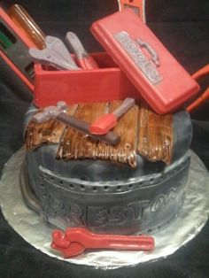 Made by LaKeisha Keck with Sweet Tooth Mother and Daughter cakes.  Manly tool  box cake with metal and hardwood floors.