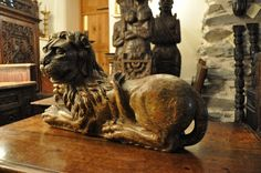 A WONDERFUL MID 16TH CENTURY CARVED SCULPTURE OF A RECUMBANT LION. CIRCA 1550.