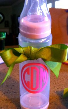 vinyl monogram labels for kid's cups and bottles. we don't actually go out with other kids much, but it's cute.