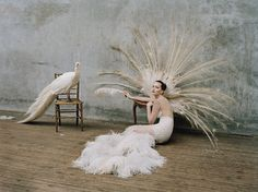 jennifer lawrence, shot by tim walker for w magazine. check out that ostrich feather and sequin-embroidered tulle gown.