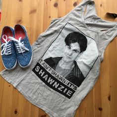 Boy Meets World Tank Top Long razor back tank with Shawn from Boy Meets World! Gray tank with black and white print. So cute with shorts or jeans this summer! Perfect for the Boy Meets World fan in your life!  No trades, make an offer! Hot Topic Tops Tank Tops