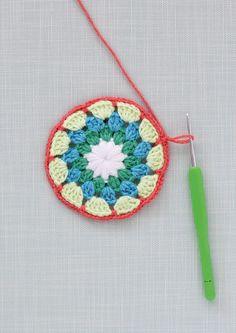 Colourful crochet mandala patterns - Mollie Makes Crochet Earrings Pattern, Crochet Mandala Pattern, Crochet Circles, Crochet Stitches Patterns, Stitch Patterns, Crochet Wool, Crochet Blocks, Free Crochet, Yarn Organization