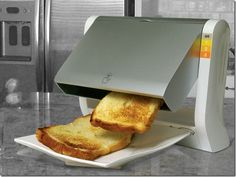 Toaster tips toast over onto plate. Hopefully it won't end up on the floor.