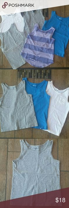 💥BUNDLE💥 GAPKIDS TANKS 5 girls tank tops Gray, blue and white all same with pocket on chest Dark and light purple hi-lo tank Gray ribbed tank No rips or holes Only stain on any is a bluish mark on the white one. I have not tried to remove it Smoke free home GAP Shirts & Tops Tank Tops