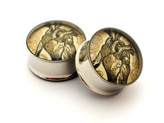 Hey, I found this really awesome Etsy listing at http://www.etsy.com/listing/80925172/vintage-heart-picture-plugs-gauges-2g-0g