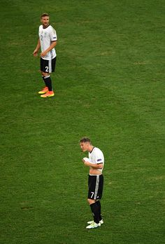 #EURO2016 Shkodran Mustafi and Bastian Schweinsteiger of Germany react after France's second goal during the UEFA EURO semi final match between Germany and...