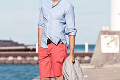 men summer fashion. Love this! Coral shorts and blue button down shirt. Perfect Spring or Summer color combination.
