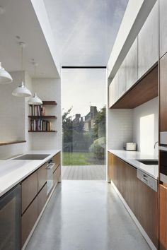 The Garden Kitchen brief was to open up the ground floor living spaces, whilst reconnecting the core of the house to the sunny south facing garden. Küchen Design, Home Design, Interior Design, Kitchen Interior, New Kitchen, Kitchen Window Bar, Wooden Kitchen, Kitchen Decor, Interior Minimalista