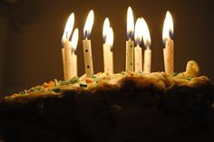 polka dot candles and a sprinkly cake.